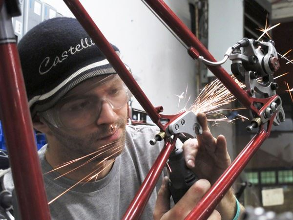 bicycle mechanic working on circle a cycles frame