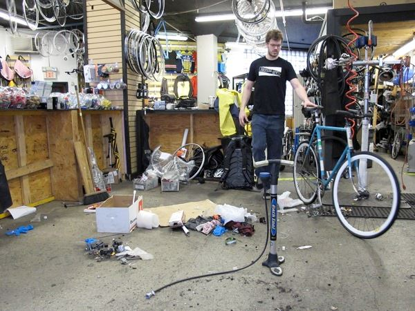 Bill with bicycle in our torn down repair area