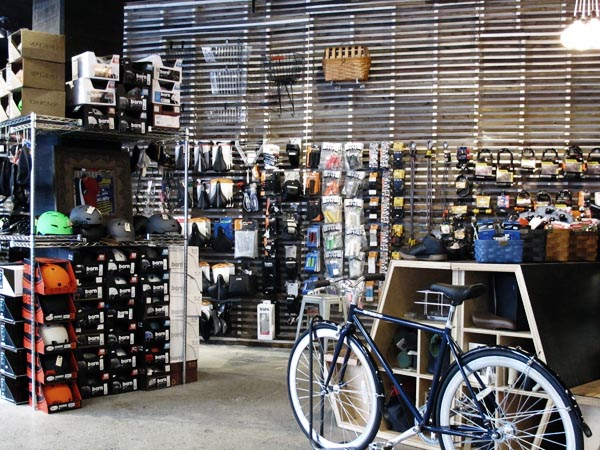 Bicycle store renovation update - new slatwall bicycle bag wall accessories