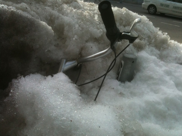Boston winter -- bicycle buried in snow