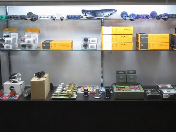 Display case with accessories by Brooks, Chris King, Serfas, Gotham City, Linus, Odyssey
